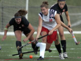 Kent Denver Sun Devils' #18, Greta Meyer, center, battles for the  ball between Colorado Academy...