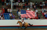 (GREELEY, COLO., JULY 2, 2004)    Stampede rider, Lee Barrett races around the arena with the...