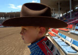 (GREELEY, COLO., JULY 2, 2004)   Mutton Bustin' rider, Tanner Aenchbacher, 7, of Ault, Colo.,...