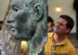 (Denver, Colo., July 4, 2004) Chad Wells, of Highlands Ranch, looks at a sculpture called,...