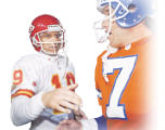 Kansas City Chiefs Joe Montana with Denver Broncos quarterback, John Elway