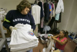 Volunteer Marilynn Allen (cq, left) of Littleton laughs with fellow volunteer Cyndi Williams (cq,...