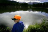 Eight year-old Alexander Moody (cq) of Springfield, Ill. fishes for trout in Sprague Lake at Rocky...