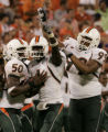 SCMC104 - Miami's Kenny Phillips (1) celebrates his interception with his teammates left Rocky...