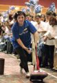Jun Fu (cq) a housekeeper from the Adams Mark Hotel, competes in the Vacuum Relay at the 2nd...