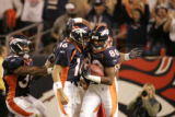 JPM0009 Denver Broncos wide receiver Rod Smith is congratulated by quarterback Jake Plummer...