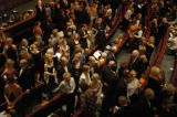 Audience members prepare to sit down after intermission at the Opening Celebration Ceremony for...