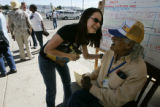 Nea Sullivan (cq), shelter assistant manager for the Red Cross, laughs with Hurricane Katrina...