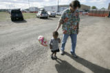 Robert Kesmarki (cq), of Denver, waits with Noah Nafziger, (mom) 2, of New Orleans, in a parking...