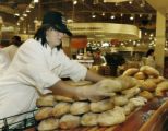 Denver, CO Sept. 12, 2005 Jennifer Jones stacks freshly made loaves of bread in the bakery...