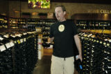 Denver, CO Sept. 12, 2005 Geof (cq) Ryan, the West wine buyer for Whole Foods, stocks the wine...