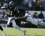 San Diego Chargers LaDanian Tomlinson eludes Dallas Cowboys Keith Davis in this 4th quarter run...