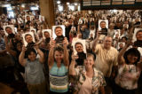 DENVER, COLO. - JULY 20, 2004  Hundreds of people hold up their copies of Bill Clinton's...