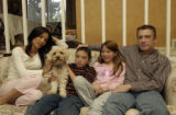 Stacy, Annie the dog, Peter Jr., Shelby, Peter Sr., all sit together in the family home.  Stacy...