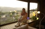 Renee sits on her window sill with a great view of Table Mountain. Renee Azerbegi, (cq), at her...