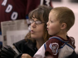 Three year old Cian Howery and his mother, Jean (cq), of Golden watch the Colorado Avalanche...
