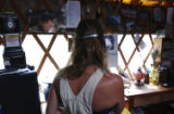 Ophir, CO. June 2004 Angelina Wolf in her solar and hydro powered yurt built by her husband Dave,...