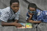 Eyes of the Hurricane portraits.  September 16, 2005. Brothers Kameron Butler, (cq) 9, left, and...