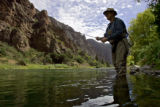 Gaylen Wallace of Palisade fly fishes near the East Portal just outside the boundaries of the...