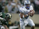 JPM034 Air Force Academy Falcons quarterback Shaun Carney, #5, runs past Colorado State Rams...