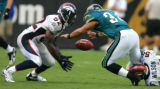 Denver Broncos Al Wilson (right) causes Jacksonville Jaguars Alvin Pearman to fumble in the Fourth...