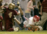 Kent Denver's Ian Ferrell, right #11 whte, dives past Faith Christian's Tom Payne, left #4 red,...