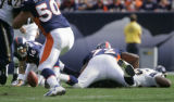 The Denver Broncos' Jake Plummer (#16, QB) searches for the ball after fumbling against the San...