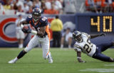 The Denver Broncos' Rod Smith (#80, WR) leaves the San Diego Chargers' Jamar Fletcher (#25, CB)...