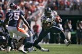 San Diego Chargers running back Michael Turner makes a move trying to get by Denver Broncos safety...