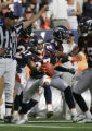 The Denver Broncos' Darrent Williams (#27, CB) celebrates with teammates after an apparent...
