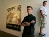 Artists Wes Hempel (dark clothes, left), and Jack Balas (white shirt), at in front of their...
