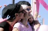 (L-R)  Kimber Charp (cq) center  is hugged by her father Robert White (left) (cq)and her husband...