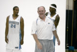 Second year Denver Nuggets head coach, George Karl, middle, walks away from a back drop after...