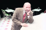 "Pulitzer prize-winning playwright August Wilson photographed on the set of ""Two Trains..."