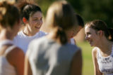 Dina Rouff (cq), 17, left, laughs with her field hockey teammates during practice, including Megan...