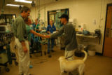 Lance thanks the medical team for all their help  with his dog Rex, a yellow lab, at Colorado...