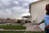 Maria Saldival, cq, waters her lawn in her southeast Greeley subdivision on Wednesday, September...
