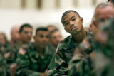 Colorado National Guardsman SSG Anthony Alston (cq) of Colorado Springs listens to speakers during...