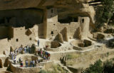 A ranger-led tour makes their way through the Cliff Palace site at Mesa Verde National Park one...