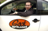 Daniel Ross (cq) a member of the Best Buy Geek Squad, arrives in his company car on Wednesday...