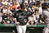 Rockies first baseman, Todd Helton, left, strikes out for the final out of the 7th inning of play...
