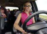 (Castlerock, Colo., July 8,  2004)    Kristin (cq Kristin) Varela, demonstrates the automatic side...
