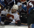 Avalanche goalie David Aebischer protects the goal from the Flames' Chris Simon in the second...