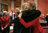 Gigi Dennis (cq) (right)  is hugged by Pueblo County Judge Adele Anderson (cq) after Anderson ...