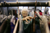 Edna Cary (cq) 100 years old, arranges clothing on racks at the Second Hand Shoppe where she ...