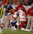 Denver Broncos wide receiver Rod Smith pulls in a pass while being covered by Kansas City Chiefs...