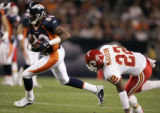 Denver Broncos wide receiver Rod Smith sprints past Kansas City Chiefs cornerback Dexter McCleon...