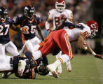 Denver Broncos safety Sam Brandon drags down Kansas City Chiefs tight end Tony Gonzalez during...