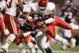 Denver Broncos wide receiver Rod Smith is face-masked by Kansas City Chiefs cornerback Dexter...