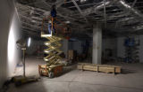 Workers install ceiling supports in the first floor special exhibition space as construction...
